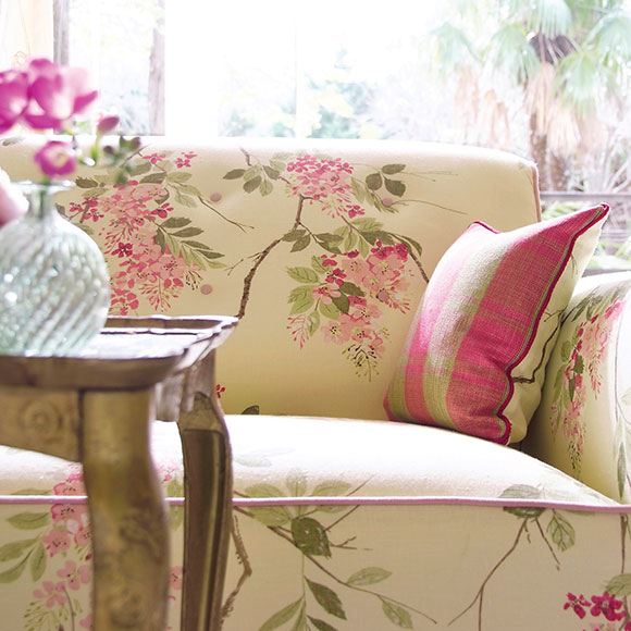 Sofa with flower design on it and pink pillow