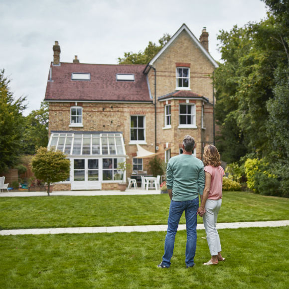 Couple in garden of fancy home