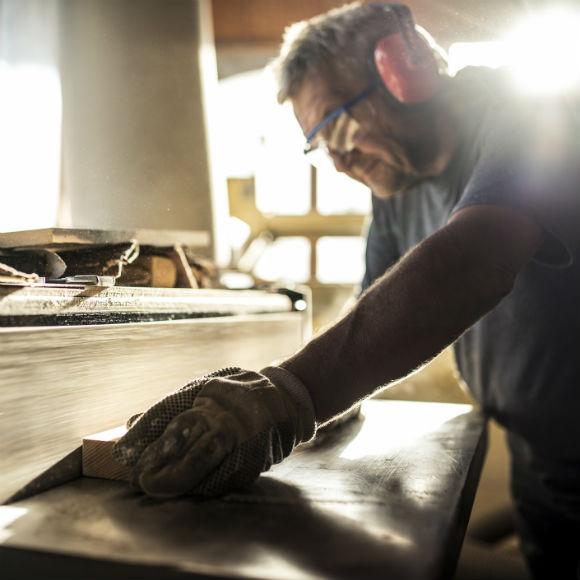Carpenter working against belt sander